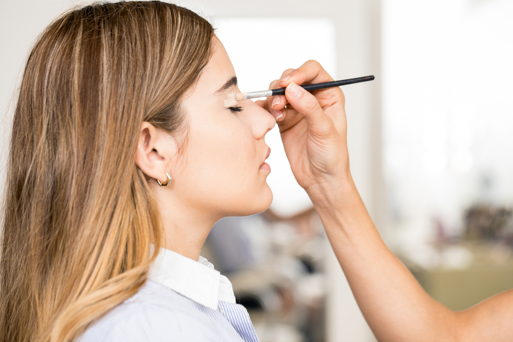 Profile of a woman getting makeup done