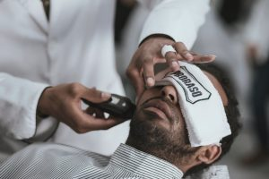 man at the barber's getting a shave