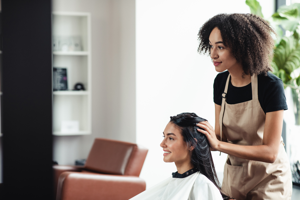 woman looking in the mirror at the salon