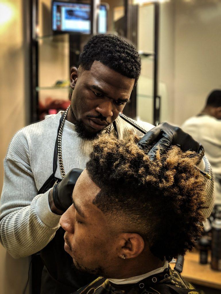 Man cutting hair in a barbershop.