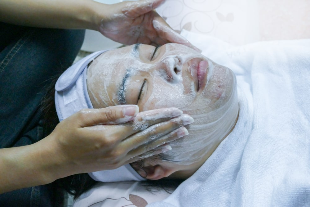 Woman getting a service from an esthetician